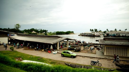 The fishing port of Kribi. The fishermen sell their catch straight out of their pirogues.