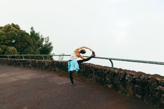 Girl stretching, Kaua'i, Hawaii