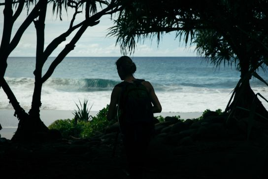 Woman in front of Hanakapiai Beach, Kalalau Trail, Kaua'i, Hawaii