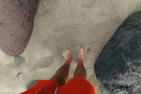 Feet on Kalalau Beach, Kalalau Trail, Kaua'i, Hawaii