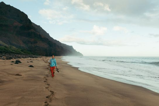 Woman walking Kalalau Beach, Kalalau Trail, Kaua'i, Hawaii