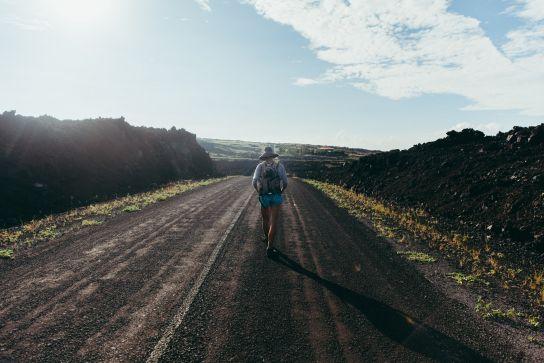 Girl hiking on the road, Ocean View, Big Island, Hawaii
