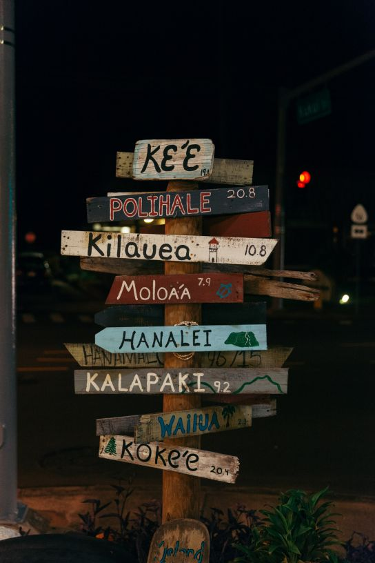 Sign with destinations and distances, Kapaa, Kauai, Hawaii