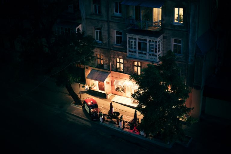 Shot from above of a restaurant in Odessa, Ukraine. Silhouette drawn with chalk on the pavement.